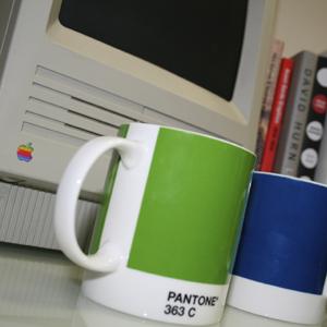Photo of Pantone mugs and classic Mac
